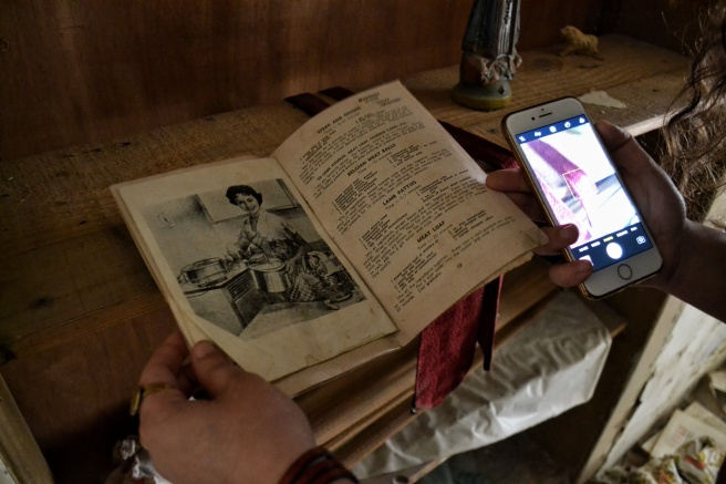 Mezher examines an old recipe book from the 1950s